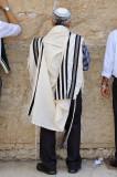 Jewish religious man praying at Western Wall
