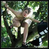 The young beauty in trees, lingerie, topless and nude attitude!