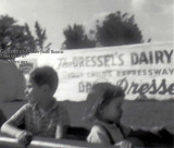 1964 - David Booth and Nancy Joan Booth riding the train at Dressel's Dairy on Milam Dairy Road