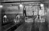 Bowling alleys with manual pin setters