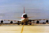 Late 1970's - Air Canada B747-100 with baboon nose taxiing in to the gate