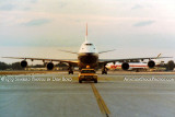 1979 - one of my buddies escorting the daily British Airways B747-100 to the gate at MIA with a Western DC-10 in the background