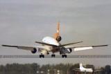 1979 - a VIASA DC10-30 landing on runway 30 as a Marco Island Airways Martin M-404 taxies in