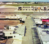1976 - view of old Concourse E and the new E-Satellite under construction