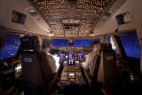747-8 cruising in a moon lit sky
