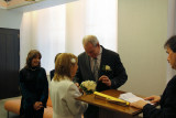 Moshe gives Orna her wedding ring during their wedding ceremony - at the City Clerk's Marriage Bureau in Manhattan