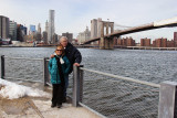 Orna and Moshe at the Fulton Ferry Landing Pier in Brooklyn with the Brooklyn Bridge, East River and Manhattan in the background