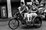 Sightseeing tourists taking a ride on a trishaw