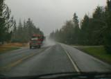 log truck, wet road