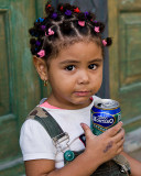 Little girl with a can of pop