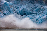 Glacier ice falling in to the ocean creating big waves