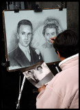 Drawing artist copying old wedding photography
