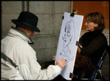 Drawing artist making a caricature