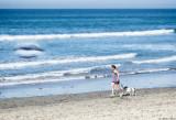 Woman and Dog at Beach