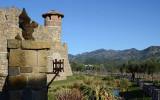 Gargoyle Overlooks Moat & Mountain Setting