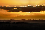 clouds around setting sun