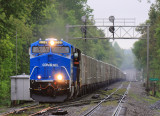 CR heritage unit 8098 leads NS 264 North through a cold rain at Junction City