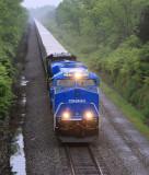 NS 264 rolls North through the rain and fog