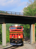 NS Heritage 8114 eases train 387 under the Clinchfield bridge, as they start down the steep grade at Speers Ferry