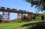 NS 50A is making a run for the steep grade up Kings Mountain as they cross the Green River Bridge at Southfork.