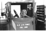A1C Mark Smoot & Jake-0X14 posting truck.  Jake never got the hang of backing up. April 1971