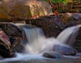 Sunlight on small stream cascade.jpg