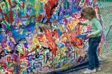 Budding artist contributes to the Community Mural