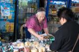 A storekeeper near the Mahathai U Thit Bridge