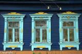 Fretwork windows of a log home, or Izba