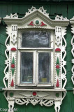 Fretwork windows of a timber cottage, or Izba