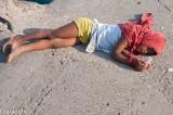 Beggar girl aslep on the Haji Ali Mosque causeway