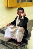 Malay man playing a mouth organ