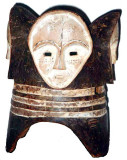 Fang Ngontang dance mask, north of Libreville, northern Gabon. Classic helmet mask with four kaolin-painted faces. Height 38 cm.