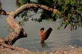 Girl fishing for tiddlers