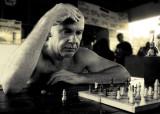 Don doing chess on Don Det.