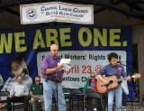 Butte County Health Care Coalition founder Tom Reed sings along to Jim Williams
