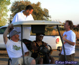 Chali 2Na gets a ride from his keyboardist; also in photo are festival co-directors Bob Backstrom (left), Steve Swim (right)