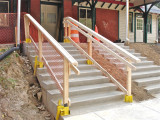Stairs with temporary railing