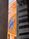 A glimpse of a fresco through the columns