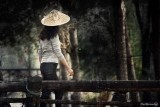 Ethnic Cultural Park.The Chinese  Woman on the Bridge