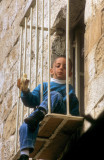 Kid in Caged Window...