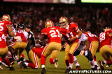 San Francisco 49ers QB Alex Smith hands off to RB Frank Gore