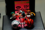 NFL Huddles, helmets of Jets/Bengals with press credential and Tim Tebow figure Tebowing