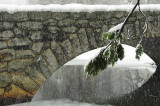 Snow falls over the Stoneman Bridge