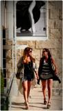 Two Women Beneath a Poster at the Getty Center
