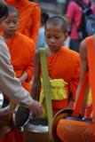 Monk receiving an offer