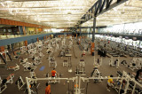 BEYOND THE FAR WALL OF THE FITNESS CENTER ARE THE BASKETBALL COURTS