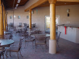 THERE IS A LOT OF SEATING IN THE PATIO AREA NEAR THE POOL