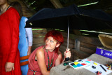 Under umbrella in hut
