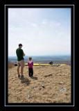 Steve and Norah watch a paraglider prepare